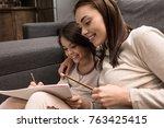 portrait of smiling family... | Shutterstock . vector #763425415