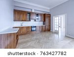 the kitchen is solid wood in a... | Shutterstock . vector #763427782