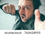 aggressive man punching with... | Shutterstock . vector #763428955
