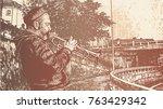 a street musician plays a... | Shutterstock .eps vector #763429342