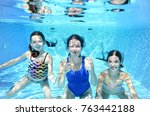 Family Swims In Swimming Pool...
