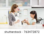 happy mother and child in... | Shutterstock . vector #763472872