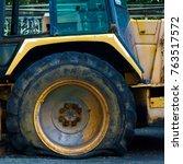 a big wheel flat tire of broken ... | Shutterstock . vector #763517572