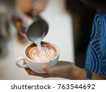 pouring milk make latte art  | Shutterstock . vector #763544692