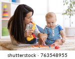 woman and baby playing musical... | Shutterstock . vector #763548955