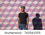 young hipster man in cap... | Shutterstock . vector #763561555