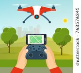 hands holding drone's... | Shutterstock .eps vector #763576345