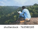 asian man travel relax in the... | Shutterstock . vector #763580185