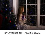 dreaming girl teenager sits on... | Shutterstock . vector #763581622