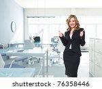 happy businesswoman thumbs up...   Shutterstock . vector #76358446
