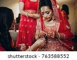 stunning indian bride dressed... | Shutterstock . vector #763588552