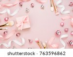 Stock photo frame with christmas ball gift ribbon cosmetic and decorations in pastel pink colour holiday 763596862