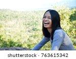 woman smiles happily. | Shutterstock . vector #763615342