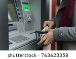 man taking cash from atm with... | Shutterstock . vector #763623358