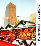 Small photo of PARIS, FRANCE - NOVEMBER 26, 2017: Christmas market in La Defense. La Defense is a major business district of Paris and a largest open-air contemporary art gallery in France.