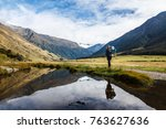 a young traveler woman with a... | Shutterstock . vector #763627636