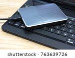 external hard disk on laptop. ... | Shutterstock . vector #763639726