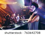 shot of a female dj playing... | Shutterstock . vector #763642708