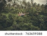 young tourist woman swinging on ... | Shutterstock . vector #763659388
