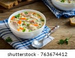 chicken and wild rice soup.... | Shutterstock . vector #763674412