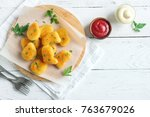 chicken nuggets and sauce on... | Shutterstock . vector #763679026