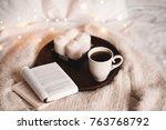 cup of tea with open book on... | Shutterstock . vector #763768792