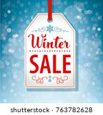 winter sale tag label on blue...   Shutterstock .eps vector #763782628