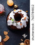 Small photo of Traditional christmas cake with dried fruits soaked in rum and sugar glaze. T