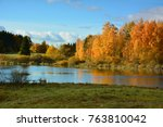 autumn landscape with lake | Shutterstock . vector #763810042