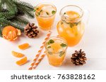 mandarin cocktail with ice and... | Shutterstock . vector #763828162