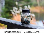 mason jar filled with river... | Shutterstock . vector #763828696