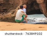 father and son looking at the... | Shutterstock . vector #763849102