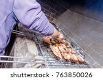 barbecue meat with a hand... | Shutterstock . vector #763850026