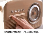 person tuning retro radio ... | Shutterstock . vector #763880506