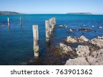 Small photo of Old pier at Plimmerton looking towards Mana Island.