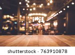 Stock photo wood table top bar with blur light bokeh in dark night cafe restaurant background lifestyle and 763910878