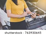 asian woman staff with...   Shutterstock . vector #763930645