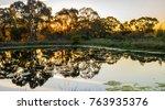 sunset over water  orange n.s.w.... | Shutterstock . vector #763935376