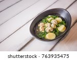 ivy gourd soup with pork on... | Shutterstock . vector #763935475