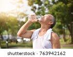 asian senior male drinking... | Shutterstock . vector #763942162