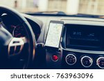 the map on the phone in the... | Shutterstock . vector #763963096