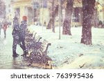 young man and woman in the snow ... | Shutterstock . vector #763995436