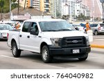 Small photo of Acapulco, Mexico - May 30, 2017: White pickup truck Ford F-150 in the city street.