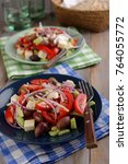 two portions of greek salad on... | Shutterstock . vector #764055772