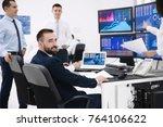 stock traders working in office | Shutterstock . vector #764106622