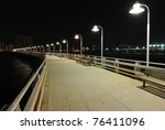 Long Pier With Lights In The...