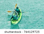 man and woman sailing on an... | Shutterstock . vector #764129725