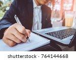 closeup businessman writing on... | Shutterstock . vector #764144668