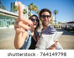 woman holding map showing... | Shutterstock . vector #764149798