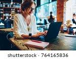 positive female freelancer in... | Shutterstock . vector #764165836